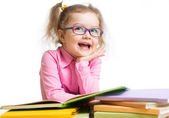 Funny kid girl in glasses reading books  — Stock fotografie