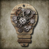 Bulb lamp with cogs and gears. Idea concept. — Stock Photo