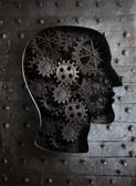 Brain concept: metal gears and cogs in human head — Stock Photo