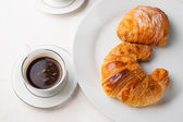 Coffee serrved with croissant and sfogliatella(typical Napoli sw — Stock Photo