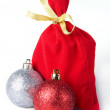 Gift sack and Christmas balls — Stock Photo