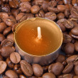 Burning candle and coffee beans — Stock Photo