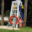 Place of lifeguard on a beach . Ladder with platform, lifebuoy, life jacket — Stock Photo