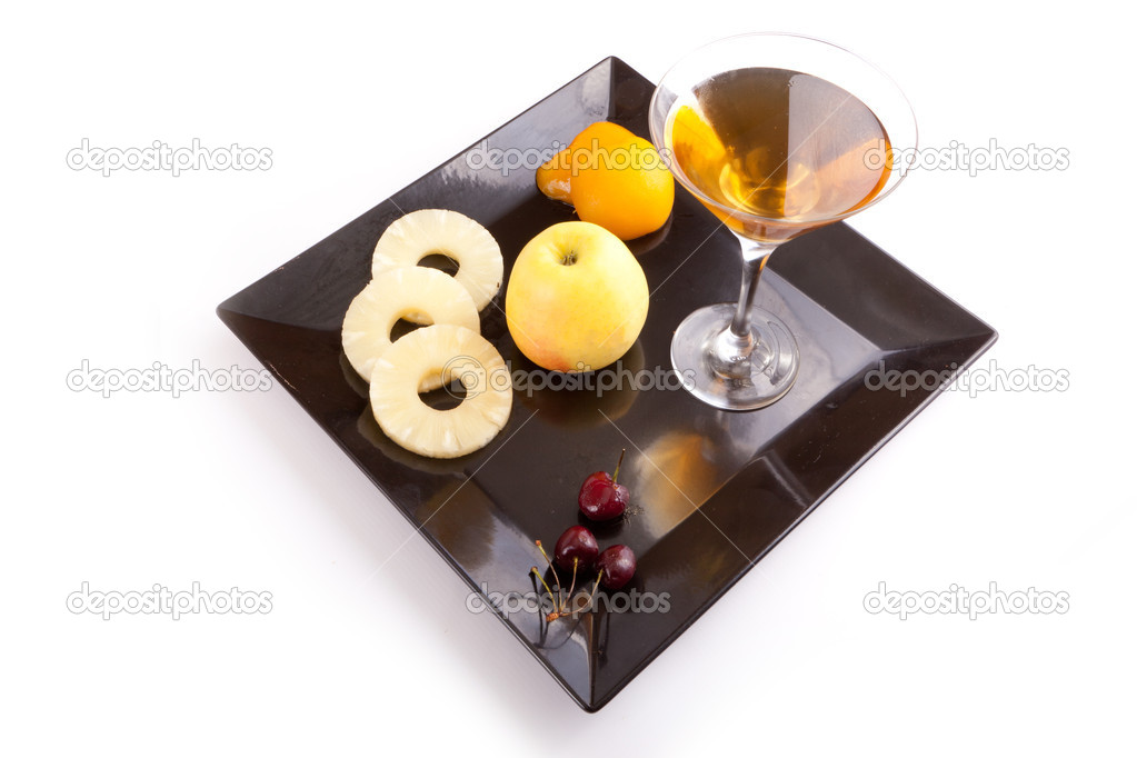 Apple, Pineapple, Peach and Cherries Slices with Fresh Juice In Cocktail Cup on Dish — Stock Photo #12456186