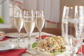 Glasses of champagne stay at the table — Stock Photo