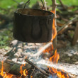 Pot for cooking on a fire in a campaign — ストック写真