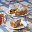 Foto Stock: Apricot pie on plate and cup with tea