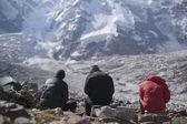 Three mens sit on the stone — Stok fotoğraf