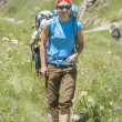Young Woman hiking in the Mountains — Stock Photo