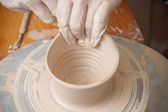 Hands of a potter — Stock Photo