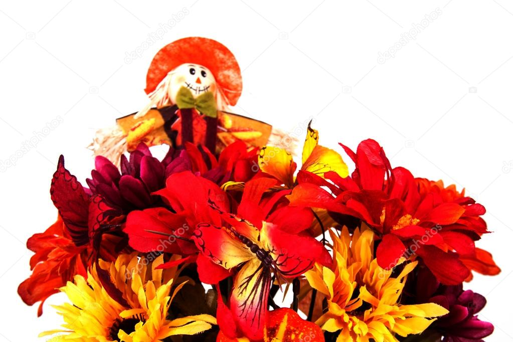 Fall basket centerpiece with scarecrow, flowers and butterflies  Stock Photo #13423148