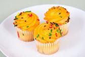 Three Miniture Yellow Cupcakes — Stock Photo