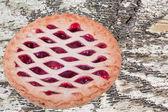 Cherry Pie On Distressed Wood Background — Stock Photo