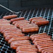 Turning Hot Dogs On Grill — Stock Photo #31252273
