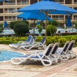 Lounge chairs pool — Stock Photo #15869197