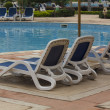 Lounge chairs pool — Stock Photo #15869199