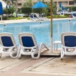 Lounge chairs pool — Stock Photo #15869205