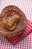 Chocolate croissants in a basket  — Stock Photo