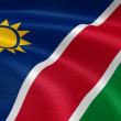 Namibian flag in the wind. - Stock Photo