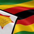 Zimbabwean flag in the wind. - Stock Photo