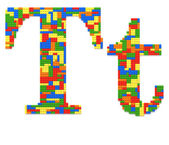 Letter T built from toy bricks in random colors — Stock Photo