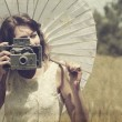 Beautiful photographer. Photo in old image style. — Stock Photo #10354843