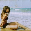 Young girl at the sea. Photo in old color image style. — Stock Photo #11921793