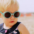 Portrait of cute 1,5 years old baby with fashion vintage sunglas — Stock Photo