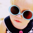 Portrait of cute 1,5 years old baby with fashin vintage sunglass — Stock Photo