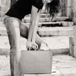 Stock Photo: Beautiful girl with vintage suitcase