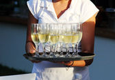 Waiter serving champagne — Stockfoto