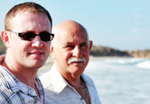 Father and son on a beach — Stock Photo