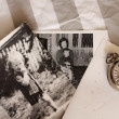 Antique pocket watches and old photos — Stock Photo