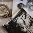 Antique pocket watches and old photos. Focus on the clock — Stock Photo #16351081