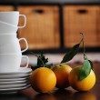White cups and organic oranges. soft Focus — Stock Photo #16351155