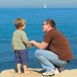 Father and son at the sea — Stock Photo