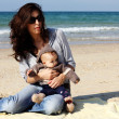 Mother with her child on the beach — Stock Photo