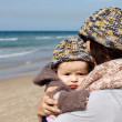 Stock Photo: Mother with her child on the beach