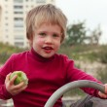 Boy with an apple — Stock Photo
