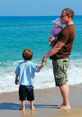 Father and his Children playing together on the beach — Stockfoto