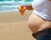 Pregnant woman's belly — Stock Photo