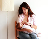 Mother breast feeding her baby. — Stock Photo