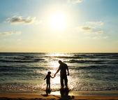 Child and his father on the beach — Stock Photo