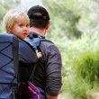 Father hiking with kid on backpack — Stock Photo