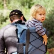 Royalty-Free Stock Photo: Father hiking with kid on backpack