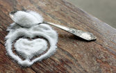 Sugar-heart on wooden background — Stock Photo