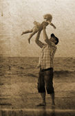 Father with daughter on vacation at sea. Photo in old image styl — Foto Stock