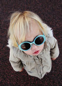 Funny 2 years old girl with sunglasses outdoors — Stock Photo
