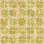 Textured paper with green clover pattern — Stock Photo