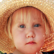 Cute little girl in the hat outdoor — Stock Photo